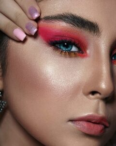 Womans face with red pink makeup